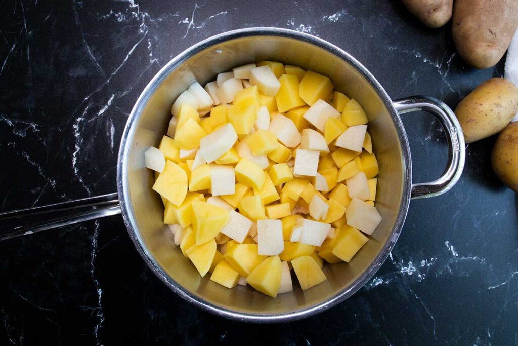 Potatoes cubed in a pot