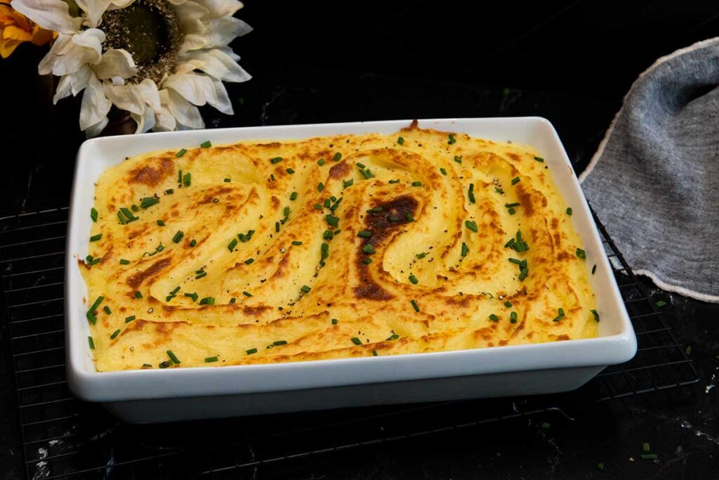 whipped potatoes in a white casserole dish