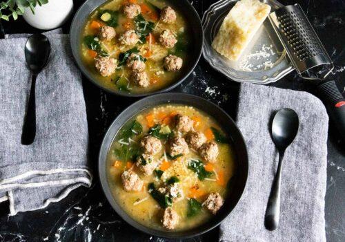 Italian wedding soup in black bowls