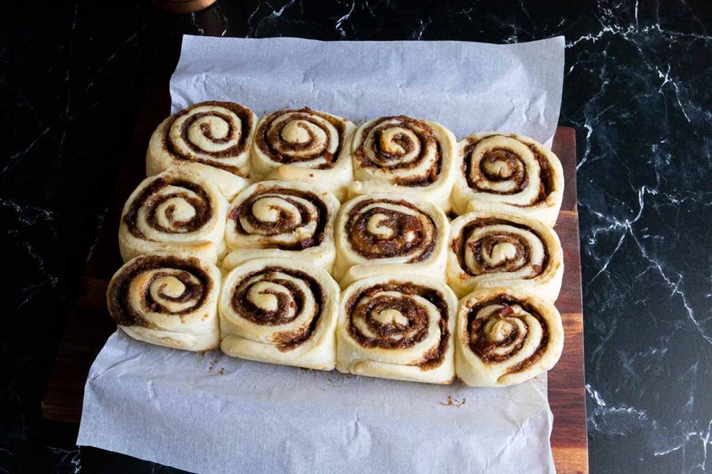 maple bacon cinnamon rolls out of the oven without icing