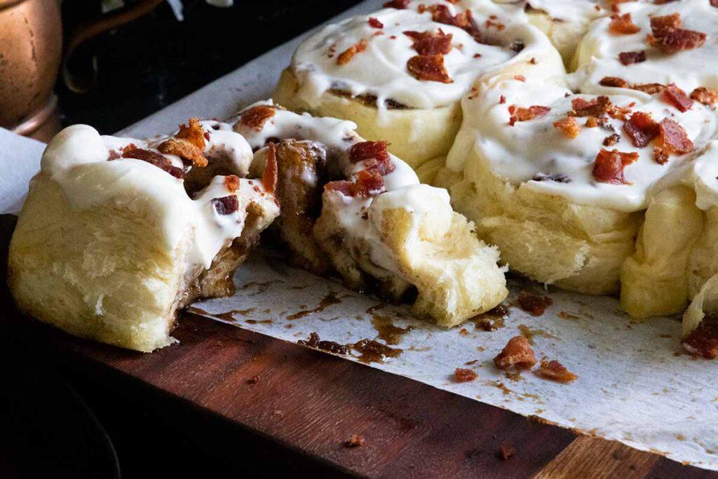 A maple bacon cinnamon roll cut open